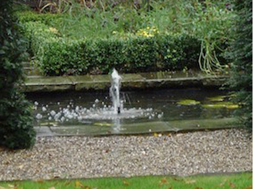 water jet in pool london garden