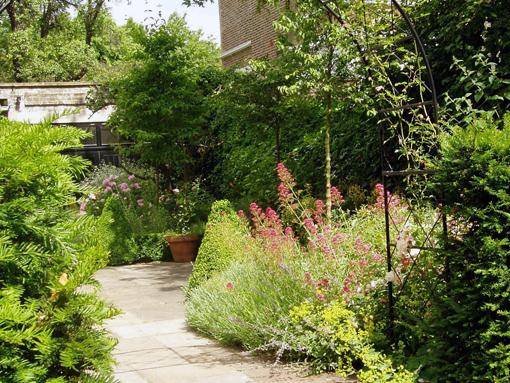 archway courtyard garden planting
