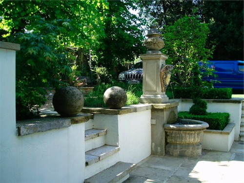 Stone steps and paving in garden is London