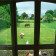 view over garden and animals grazing thumbnail