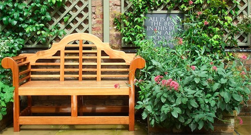 Lutyens timber bench and plaque planting design