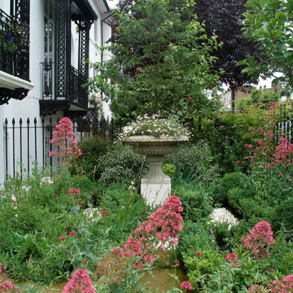 pink and white planting with urn london